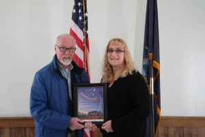 Kingfield POPS President Donald Tranten presents Kingfield Administrative Assistant Leanna Targett with a token of appreciation for the support the Town of Kingfield gives to the POPS. (Dee Menear photo)